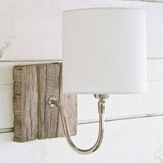 Driftwood-like, reclaimed wood wall sconce lamps with white round shades and silvered bent arm. Beach cottage perfect lighting! Comes with cord, but can be adapted to be hard-wired into your space. D