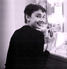 Audrey just about to put her make-up on for Ondine, 1954