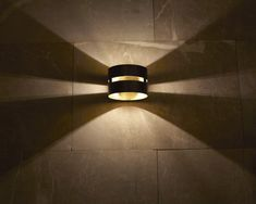The Fambuena Luz Oculta Metal wall light. Comes in dark bronze or brass and cylinder or drum shape. Brass Metal, Floor Lamp, Wall Lights, Bronze, Lighting, Nirvana, Cnc, Design, Home Decor