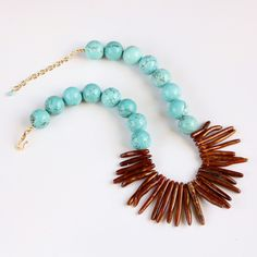 Turquoise Necklace, Gold Coral Sticks, Turquoise Magnesite, Bronze, Copper, Tropical Statement Necklace by rubyskydesign on Etsy https://www.etsy.com/listing/120849477/turquoise-necklace-gold-coral-sticks