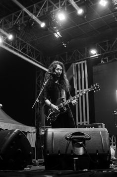 Rekti Yoewono (vocalist & guitarist) The S.I.G.I.T. (The Super Insurgent Group of Intemperance Talent)