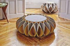 Inspired by the ornate collars from Elizabethan times, the Ruff Pouf by Gan Rugs combines function without sacrificing design aesthetic. Mixing geometry and folding techniques, the unique pleated skirt of this pouf surrounds a solid circular drum for an interesting combination of structure and abstraction that makes a bold statement in any space.