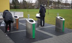 These recycling bins in Switzerland connect to large underground containers whose footprints are indicated by the black rectangles. Click image for more Swiss examples and visit the Slow Ottawa 'Street Furniture' board for many more next-level design.