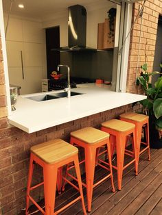 Kitchen renovation in Pasadena with gas-lift servery window.  Love the stools! www.tkdesign.com.au