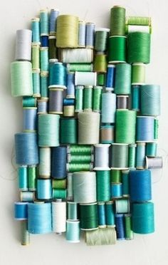 Spools in shades of blue and green.