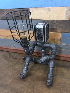 Robot Lamp, Pipe Lamp, Industrial Decor, Steampunk Lighting, Pipe Decor, Man Cave, Pipe Furniture, Pipe lamp, Robot, Industrial Lamp by TheCleverRaven on Etsy https://www.etsy.com/listing/452903010/robot-lamp-pipe-lamp-industrial-decor