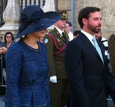 Luxembourg Royals Join Octave Procession....by HatQueen...Members of the Luxembourg Royal family took part in the closing procession of the Octave of Our Lady of Luxembourg (a two week annual religious celebration) yesterday...Hereditary Grand Duchess Stéphanie wore a navy straw hat complete with diagonal raised brim and large navy bow on the side opposite the raised brim.