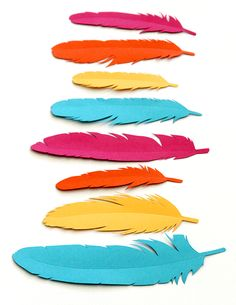 FREE PRINTABLE. These fun printable feathers have all kinds of uses: gift wrapping accents, banners, wreathes, place setting name tags, kids dress-up and more.