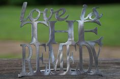 Love Is The Remedy Word Stand by AtTheEndOfTheRoad on Etsy