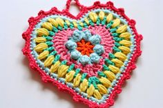 "a beautiful crochet heart potholder in her typical colors ( I luv them) by Cherry Heart: And then there were three. - she gives a link to the pattern ""Grandma's Heart (Rav link) by Carol Wijma"" Crochet Home, Love Crochet, Crochet Motif, Diy Crochet, Crochet Crafts, Crochet Flowers, Crochet Projects, Beautiful Crochet, Crochet Potholders"