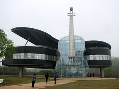 Located in Huainan City, An Hui Province, China, the Piano House was built by the local government to draw interest to the newly developed area. It's also a place where music students from the local college can practice and perform. A transparent glass violin is attached to the piano building, which features a staircase that connects the two giant instruments.