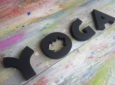 Wooden letters word YOGA written with special font and cut from plywood 3/4 for home decor, office, yoga center decoration, Pilates club, shop for yoga