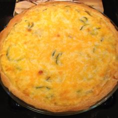Zucchini-Mushroom-3 Cheese Quiche in crescent roll crust. It's awesome served with fresh tomato slices! Preheat oven to 350, line pie pan with crescent rolls, pressing them in so they leave no holes. In large sauté pan, melt 1tbs butter, throw in 1/2 onion finely chopped, 2 small zuchinni cut up into small slices and 1 pkg sliced mushrooms. Sauté until zuchinni slices and mushrooms are soft. Add 1 pkg of shredded Colby jack cheese and 1 pkg of shredded cheddar jack cheese. Stir until melted…