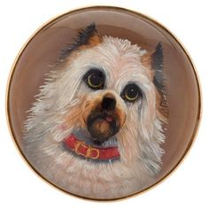 An English Antique 15 karat gold brooch. The Victorian round Essex Crystal brooch portrays a terrier wwaring a red collar, with his tongue hanging out. An affectionate portrait of a beloved companion. Circa Signed, (MG Antique Brooches, Gold Brooches, Antique Jewelry, Brooch Display, Antique Bar, Dog Jewelry, Silver Tops, English, Crystal Brooch