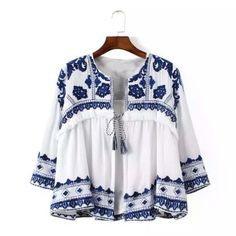 A gorgeous white base pairs with intricate blue embroidery on this expertly constructed jacket. Designed with a swingy shape, this jacket has 3/4 sleeves, fringe trim details, and a tassel tie front. Fully lined. An absolute must-have for the season. Color:White & blue 100% cotton Imported Hand wash cold Small/Medium Medium/Large Bust 36 38 Waist 36 38 Hips 39 40 Length 24 24 Bust, waist, and hip measurements are a total circumference. Length ...