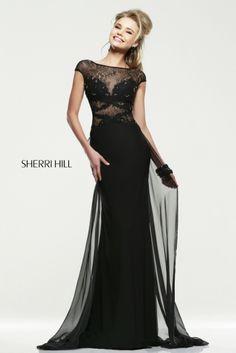 Elegante traje de noche con cuerpo de fantasía en encaje de color negro y falda con mucho movimiento