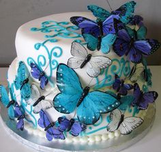 This cake, but as a wedding cake or as an overall wedding theme in general with the colors ( just tweaked a little) and butterflies. I kinda like it!