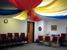 Dancing Commas | VBS Everywhere Fun Fair decorations in the choir room... ceiling draping, balloons, colored tablecloths