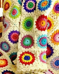 Crochet Sunburst Granny blanket.  Pale yellow background?