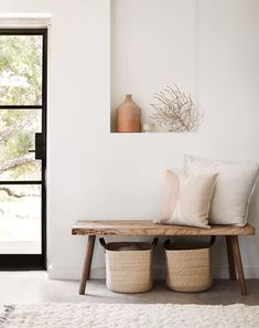 Organic And Neutral Entry Way Interior Design Ideas With Wood Bench Seating With Throw Pillows, Natural Seagrass Storage Baskets, And Wall Niche Featuring Home Decor Accessories Decor, House Design, Entryway Decor, Home Decor, House Interior, Apartment Decor, Home Deco, Home Interior Design, Minimalist Home