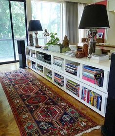 bookcases behind a couch Or maybe the bedroom wall ---> 4 bookcases from Ikea, stacked... Great idea!!