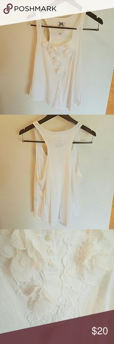 Flowered white tank! So cute! White racer back tank with flowers and lace. Worn maybe a couple times. Perfect condition. Gilly Hicks Tops Tank Tops