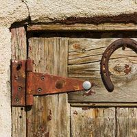Rust accumulates on door hinges when moisture is allowed to build up on the surface of the metal. The moisture mixes with oxygen and forms rust. In addition to its unsightly appearance, rust can corrode and weaken the structure of metal, causing holes to appear and increasing the possibility of the hinge breaking or snapping when the door opens. To...