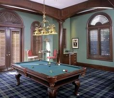 Love the dark wood trim, the shutters and plaid carpeting.  Great combination for a game room!