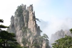 Huangshan with trees and clouds southern Anhui province in eastern China [38882592] by Arne Hückelheim