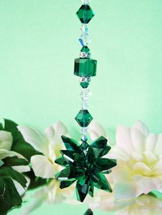 Car Mirror Hanger created with Swarovski Emerald Green and Aurora Borealis Clear Crystals. Green Crystals symbolize the energy of Balance and Harmony. Clear Crystals symbolize the energy of New Beginnings. ~Sending Love and Light to You and Your Car with Sparkling Crystal Energy~  Created with: Swarovski Emerald Green Crystal Octagons forming the starburst 8, 6 and 4mm Swarovski Emerald Green and Aurora Borealis Crystals. Swarovski Rhinestone Rondelles are added for extra sparkle:)  ~This…