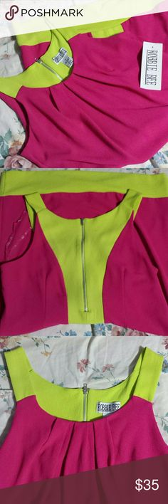 NWT amazing neon dress! Bought this, but my style has really changed. Still an amazing piece! Stand out, fun and very flattering! Robbie Bee Dresses Midi