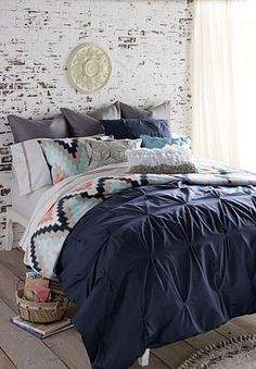 Nice dark navy color and shabby chic wall