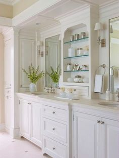 Beautiful double vanity with extra shelving in between. www.choosechi.com