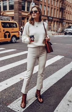 Cream sweater + simple necklace + light pants + stripes + brown leather boots