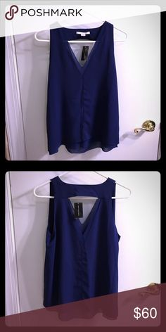Cooper & Ella cobalt sleeveless shell Double-lined cobalt sleeveless shell, classy and light, great for spring/summer, or under a jacket in winter! Cooper & Ella Tops Camisoles