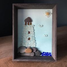 Beach glass and stone lighthouse