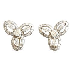 Trabert and Hoeffer Mauboussin Diamond Platinum Earrings | From a unique collection of vintage clip-on earrings at https://www.1stdibs.com/jewelry/earrings/clip-on-earrings/