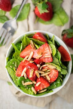 Strawberry Spinach Salad with Poppyseed Dressing:        organic raw spinach 1/2 cup strawberries 1/8 purple onion 1/4 cup pecans (can be glazed) 1/8 cup feta cheese Poppy Seed Dressing (1-2 tbs) balsamic vinegar 1 tablespoon olive oil 1 teaspoon agave nectar 1 pinch of poppy seeds