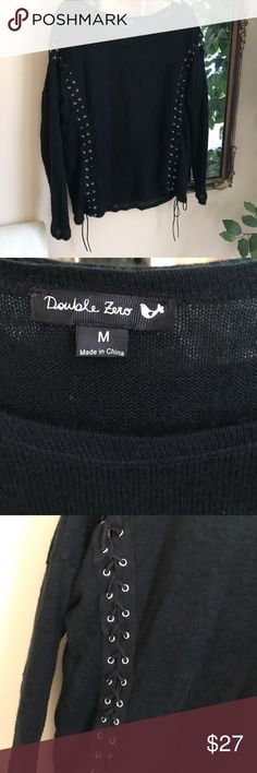 Beautiful sweater Lite knit sweater with shoe lace detailing. Really prettty. Excellent Condition. Double Zero Sweaters