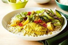 Bring your family to the table with this fragrant, coconut-rich chicken curry topped with a refreshing cucumber and lime raita.