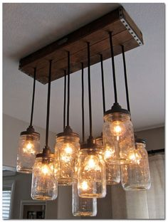 How To Make A Mason Jar Chandelier Primitive Home Decorating Every Dining Room Needs One Of These Diy Rustic Mason Jar Light Hanging Mason Jar Light Out Of Mason Jars Cafe Lights And A Wood… Mason Jar Chandelier, Mason Jar Lighting, Pendant Chandelier, Rustic Chandelier, Pendant Lights, Chandelier Video, Kitchen Chandelier, Chandeliers, Bottle Chandelier