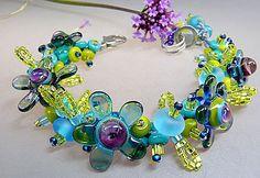 Plum  Flowers - Handmade woven lampwork glass and fiber bracelet   Manuela Wutschke