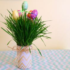 Easter Centerpieces - These are so fun and super easy to make! I planted wheatgrass in a can and added glitter egg picks from Dollar Tree. So cute!