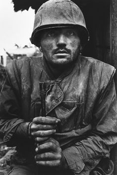 2 Hue, Vietnam, February 1968: A US marine  suffering severe shell shock waits to be evacuated from the battle zone