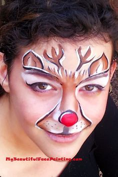 Christmas Party Rudolph face paint. Starblend powder on top of eyes.  Brown and white done with homemade split with 2 shades of Tag brown and 1 Tag white.  Nose Tag.  Outline and eyeliner in DFX black. Superstar white for accents.