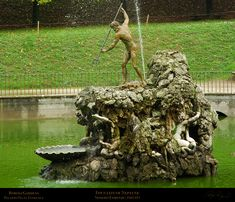 """Fountain of the Fork - Boboli's most famous spouting fountain—Stoldo Lorenzi's bronze of Neptune clutching his three-pronged trident. Irreverently known by locals as """"The Fountain of the Fork,"""" this water feature was considered the central point of the gardens."""