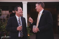 A candid photograph of wedding guests talking and laughing during the cocktail hour of Nantucket Wedding in Westmoor Club Gina Brocker Photography