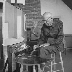 "Edward and Jo Hopper in the painting room of their studio in S. Truro, MA on Cape Cod. Hopper is working on his famous oil ""Sun in an Empty Room"", You can get a sense of how sparsely furnished the studio was."