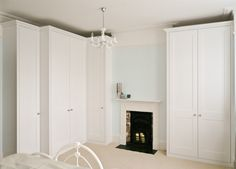 Traditional style wardrobe built to maximise alcove space.