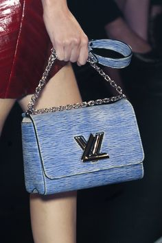 Blue Louis Vuitton Twist Malletage Bag: (http://www.racked.com/a/spring-2015-shopping-guide/accessories)